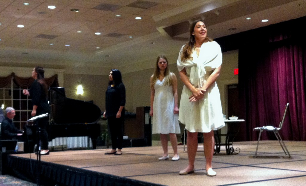 A semi-staged performance of The Clever Artifice of Harriet and Margaret, winner of the National Opera Association's 2014-2016 Chamber Opera Competition, in a hotel ballroom.