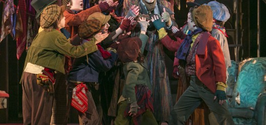 Bradley Greenwald as Fagin (center) and the cast of Oliver. Photo by Heidi Bohnenkamp.