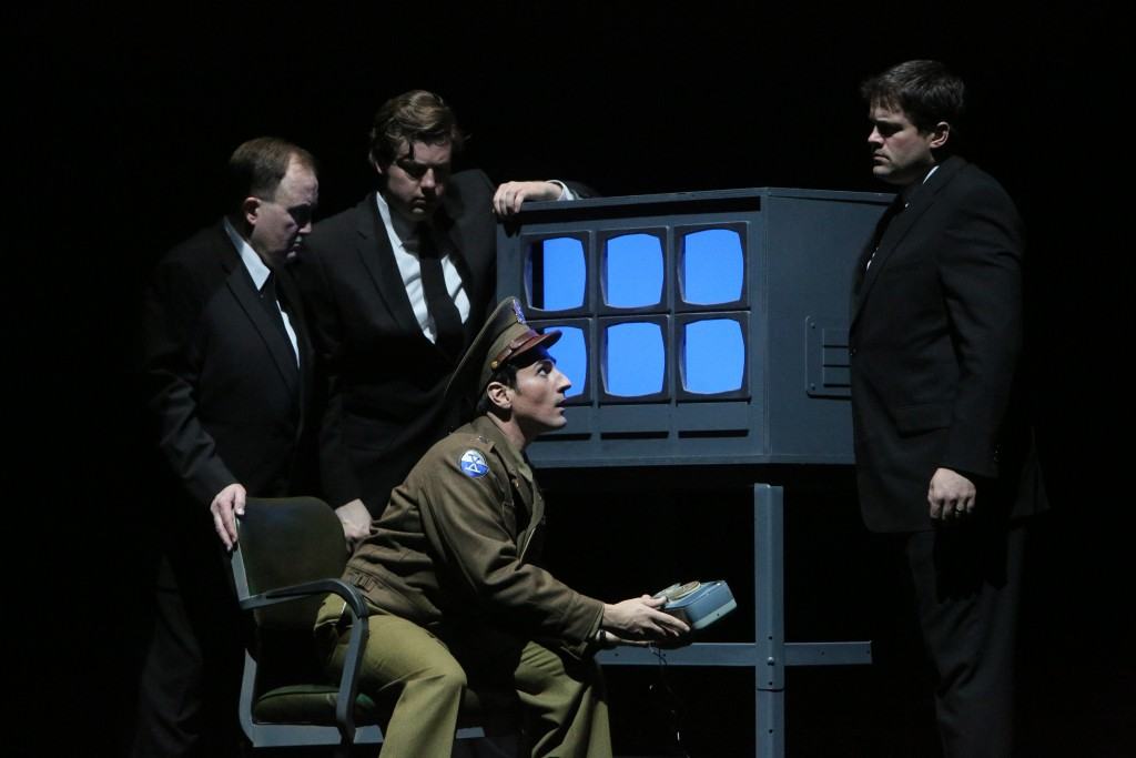 Leonardo Capalbo as Captain Ben Marco and Company in the Minnesota Opera production of The Manchurian Candidate, directed by Kevin Newbury. Photo by Michal Daniel.
